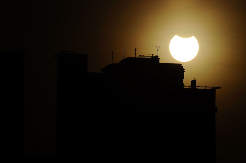 solar eclipe 2016 behind bulding in jakarta Architecture Beauty In Nature Building Exterior Built Structure Cloud - Sky Dark Glowing INDONESIA Jakarta Natural Events Nature Nature Event No People Outdoors Scenics Silhouette Sky Solar Eclipse Solareclipse2016 Sun Tranquil Scene Tranquility