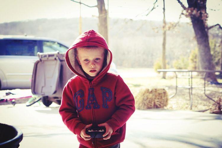 Portrait of boy standing in snow