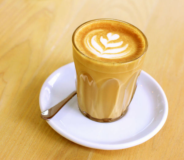 Cup of latte or cappuccino coffee Food And Drink Refreshment Coffee - Drink Drink Crockery Coffee Saucer Coffee Cup Frothy Drink Cappuccino Spoon Table Latte Froth Art Mug Hot Drink Eating Utensil Cup Kitchen Utensil Indoors  No People Glass Caffeine Cafe Cafe Time Morning Breakfast
