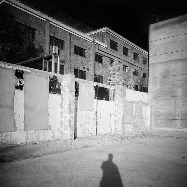 Architecture Building Exterior Built Structure Outdoors Day One Person Black And White Enjoying The View Shadows And Silhouettes Shadow Photography Tranquility Street Photography Quiet Moments Tranquil Scene Aloneee Silhouette