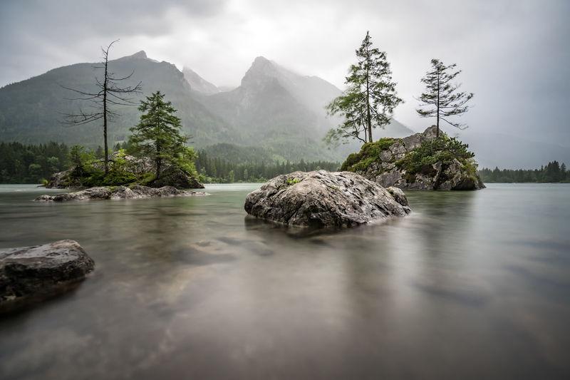 View of rocks in water against sky