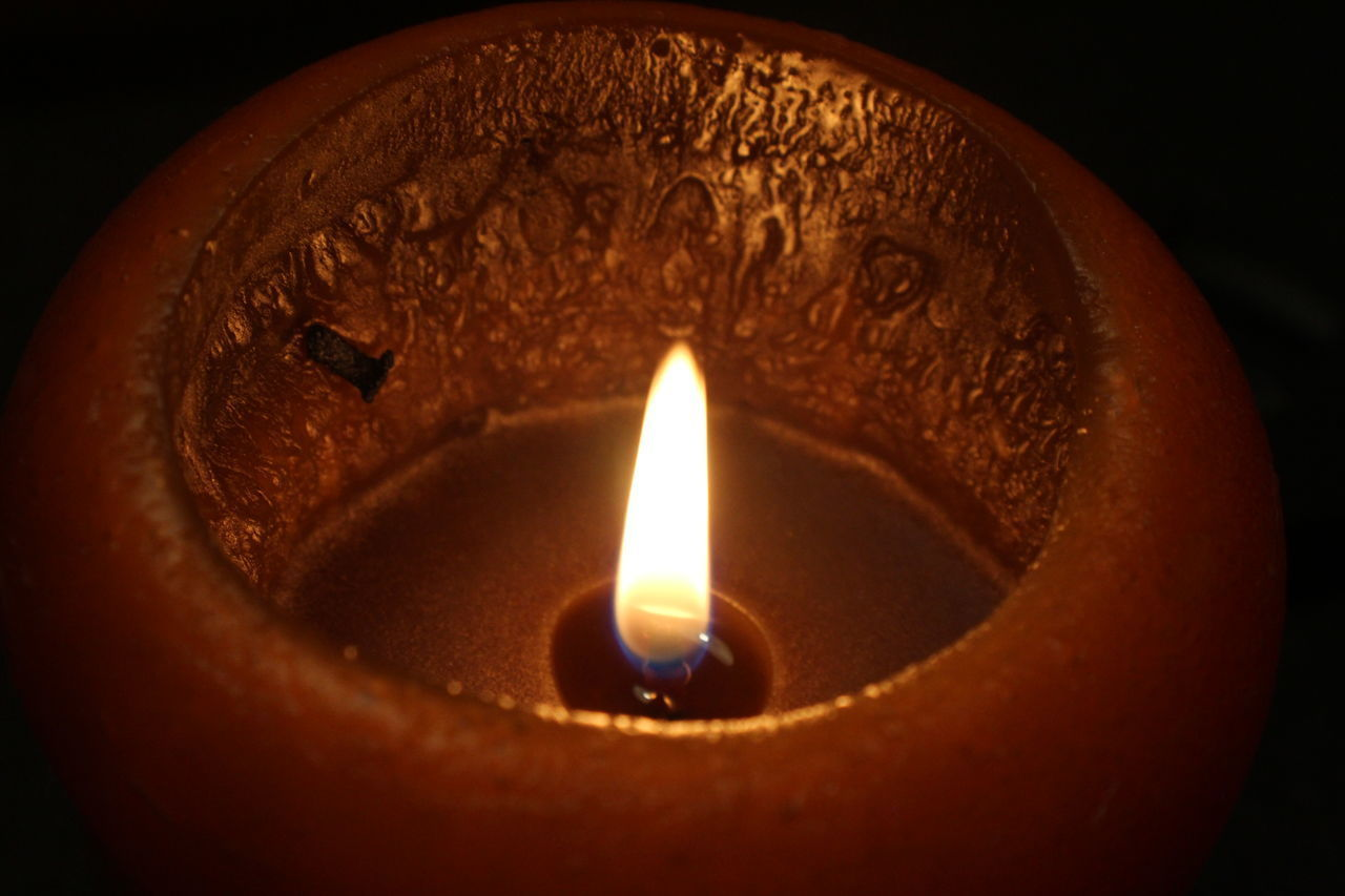 burning, flame, fire, close-up, illuminated, heat - temperature, indoors, fire - natural phenomenon, no people, glowing, candle, lighting equipment, nature, orange color, selective focus, dark, oil lamp, high angle view, focus on foreground, diya - oil lamp, electric lamp, luminosity, place of worship