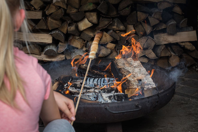 Girl from behind sitting at a fire pit waiting for stick bread, in a cosy place Bread Burning Camp Fire Campfire Cozy Cozy Place Day Daylight Fire Pit Flame Flames Flames & Fire From Behind Girl Heat - Temperature Holding Homemade Homemade Food Human Hand One Person Outdoors People Real People Stick Bread Women