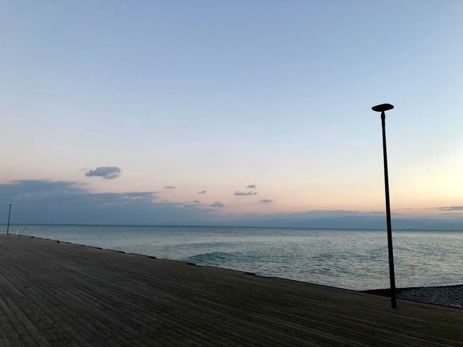 Che poi, il Mare... Sea Water Scenics Nature Beauty In Nature Tranquility Horizon Over Water Tranquil Scene Sunset Street Light Beach Sky No People Outdoors Day Silhouette