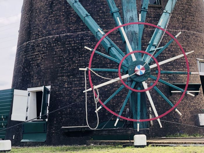 Close-up of wheel by building