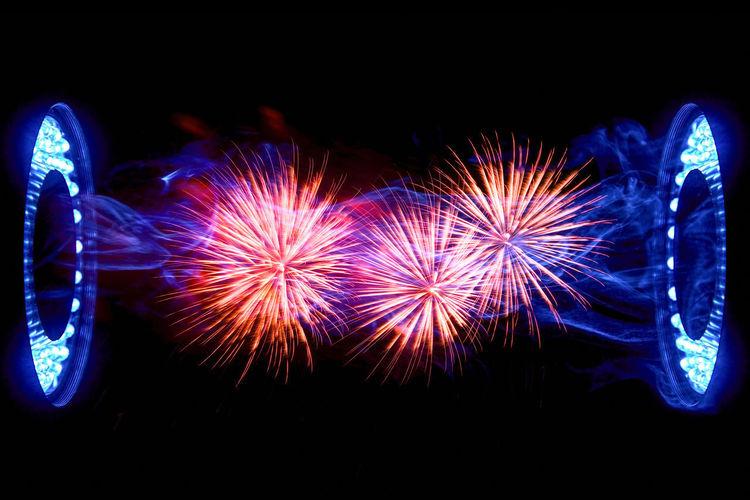 Firework display against sky at night