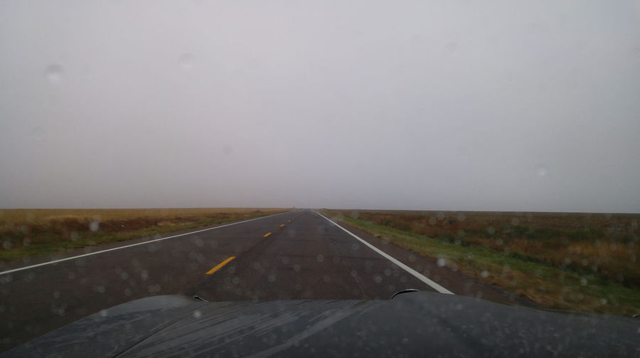 Rain Fog Weather Driving Travel Destinations Plains Prairie Colorado Remote Empty Solitude Road Highway Windshield vanishing point Diminishing Perspective The Way Forward Car Point Of View Horizon Horizon Over Land Landscape Direction Sky No People