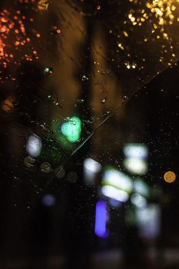 Rain RainDrop Bokeh Bokeh Photography Car Car Light Car Window Close-up Drop Drop Of Water Focus On Foreground Glass - Material Illuminated Night No People Rain Rain On Car Rain On Car Window Rain On Window Shop Lights Street Lights Water Wet Window Windshield