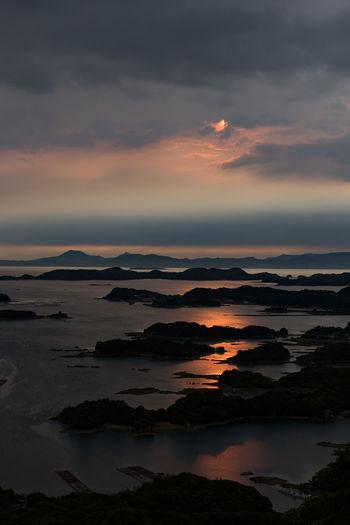 Beauty In Nature Cloud - Sky Island Nature Orange Color Outdoors Sea Sky Sunset Water