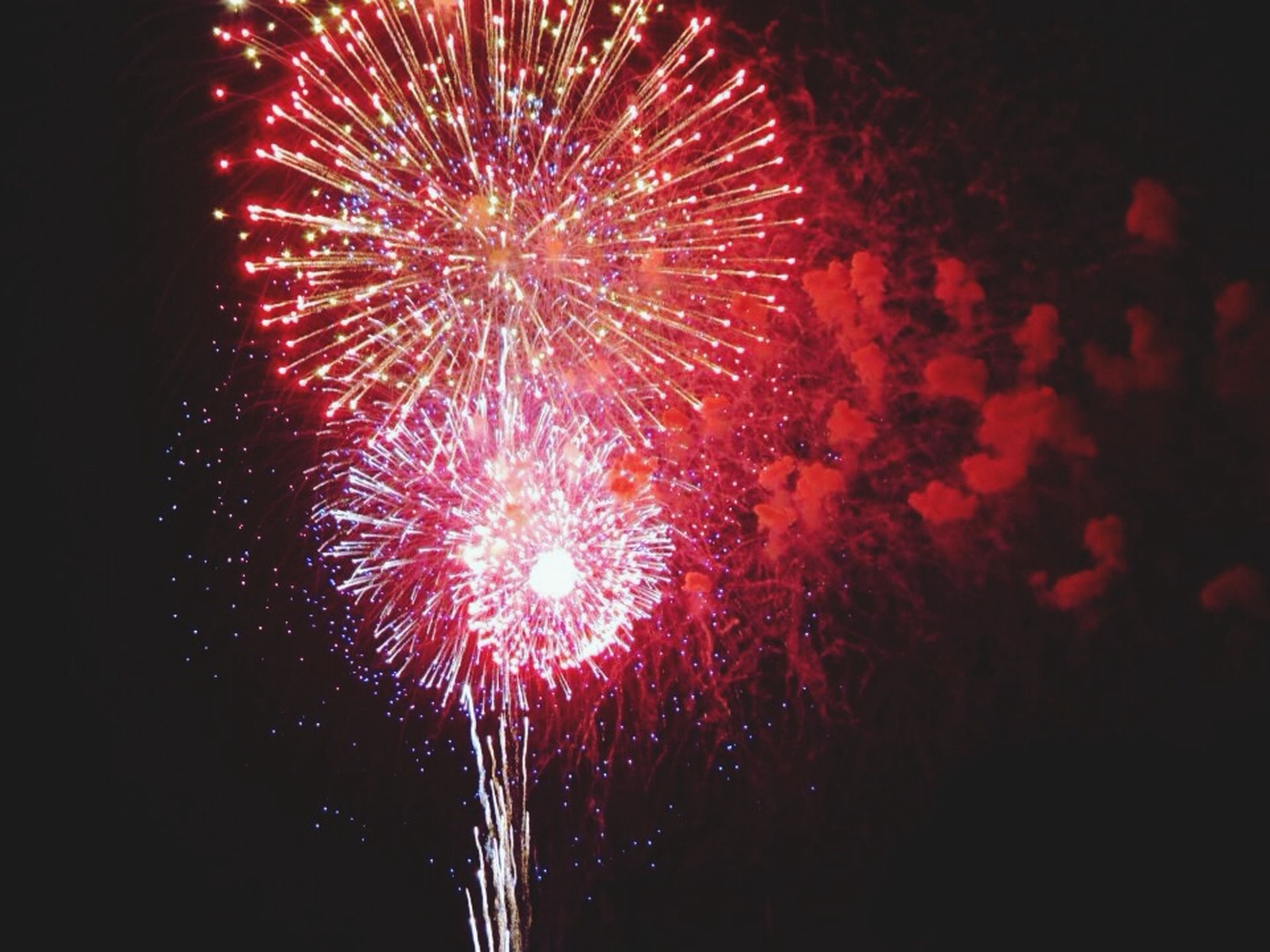night, firework display, exploding, long exposure, celebration, glowing, illuminated, firework - man made object, motion, arts culture and entertainment, sparks, event, firework, fire - natural phenomenon, low angle view, blurred motion, entertainment, multi colored, celebration event, sky