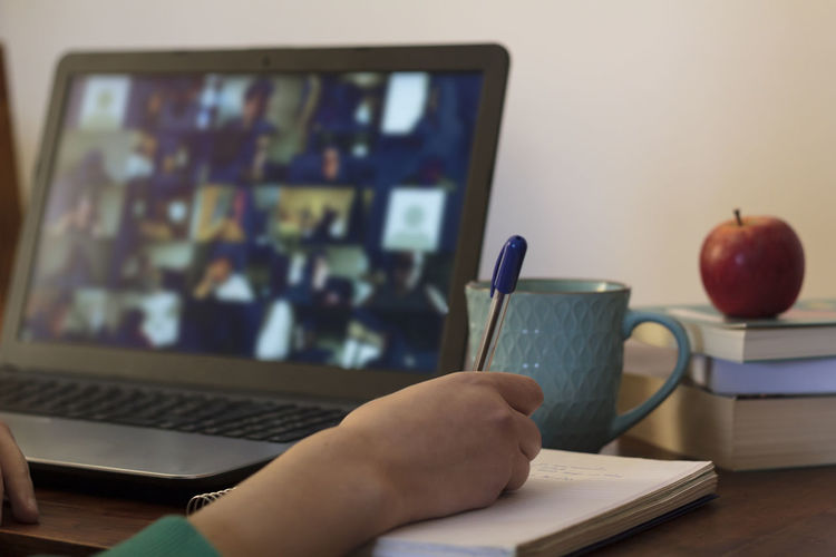 Midsection of man using laptop on table at home