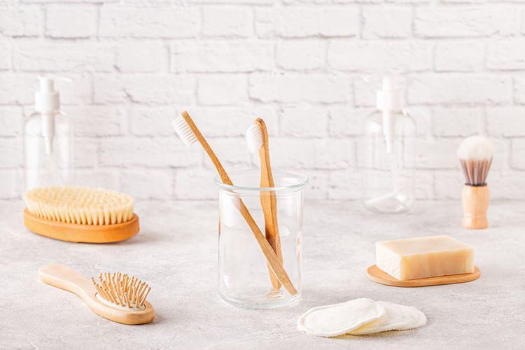 Close-up of toothbrush in glass jar on table