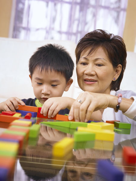 grandmother and grandson playing colorful wooden block Grandmother And Grandson Wood Block Bonding Boys Casual Clothing Childhood Colorful Concentration Day Education Enjoyment Front View Fun Happiness Home Interior Indoors  Learning Leisure Activity Lifestyles People Real People Togetherness Toy Two People Young Adult