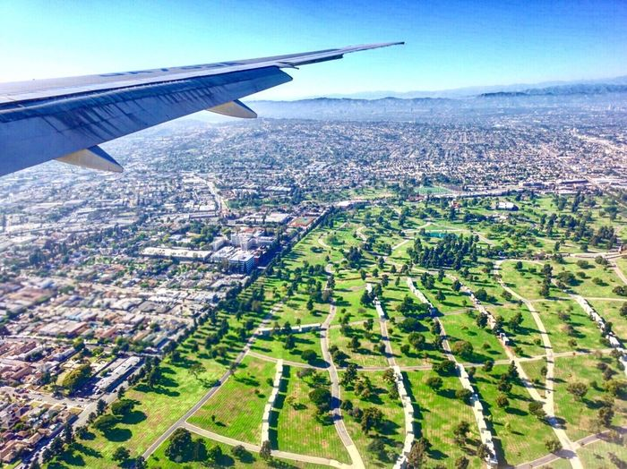 flying over LA Aerial View Airplane Flying Air Vehicle Landscape Transportation Journey Aircraft Wing Travel Mode Of Transport No People Day Scenics Mid-air Airplane Wing Sky Nature Outdoors Tranquility Patchwork Landscape