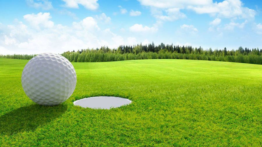 High angle view of golf ball on field against sky