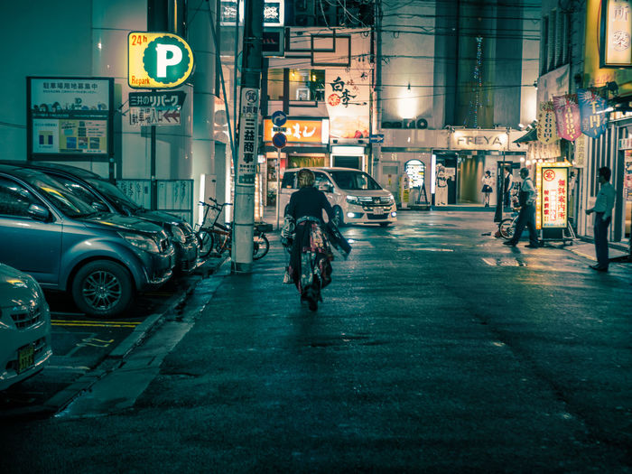 Hiroshima Cinematic Cinematic Photography Japan Japan Photography Nightphotography Architecture Bicycle Building Exterior Built Structure City Hiroshima Illuminated Land Vehicle Men Mode Of Transport Motorcycle Night One Person Outdoors People Real People Riding Street Streetphotography