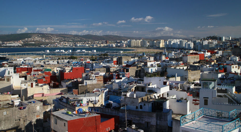 Tangier Architecture Building Exterior Built Structure City Cityscape Crowded Day Film Location High Angle View Mountain Nature Outdoors Residential Building Residential District Sea Sky Town Water