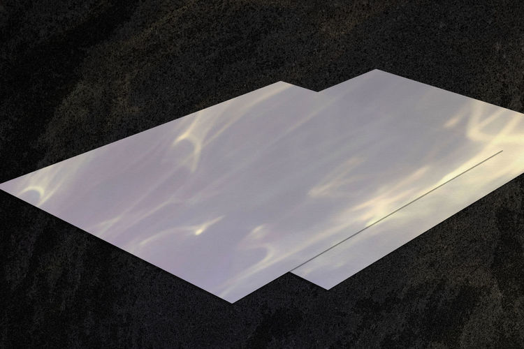 High angle view of white paper on table against wall