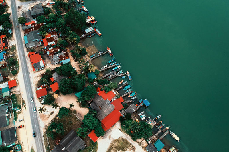 Aerial View Architecture Building Building Exterior Built Structure City Day Green Color Harbor High Angle View Mode Of Transportation Nature Nautical Vessel No People Outdoors Plant Roof Transportation Tree Water