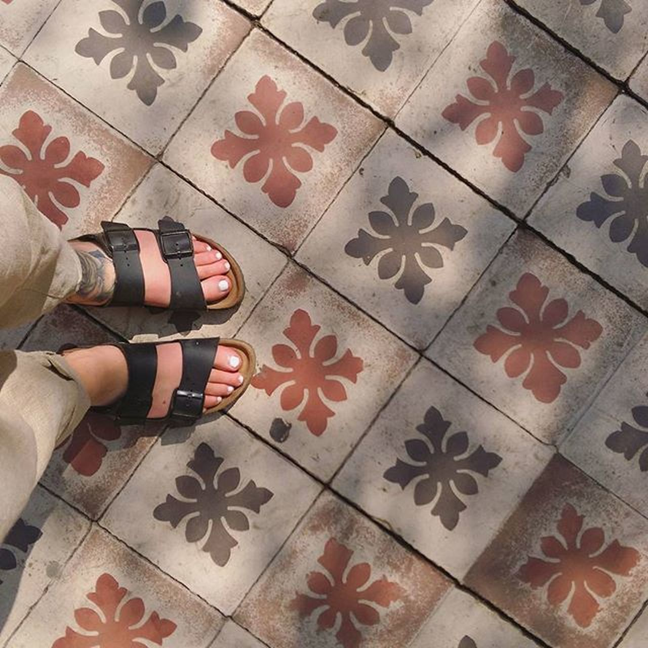 one person, human body part, indoors, low section, lifestyles, body part, pattern, directly above, tiled floor, human leg, tile, flooring, shape, leisure activity, standing, human foot, design, high angle view, adult, human limb, floral pattern