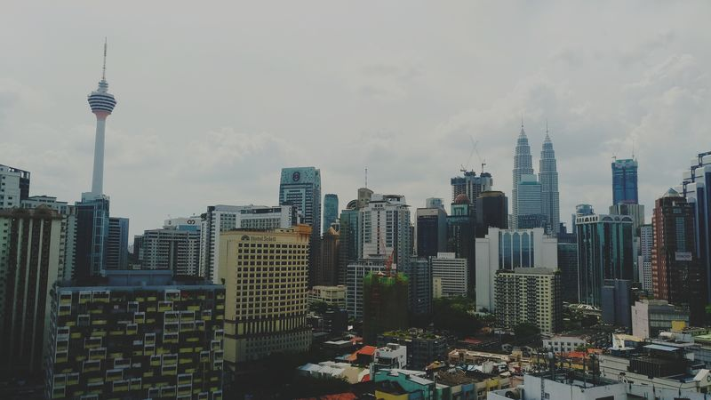 Mobilephotography Smartphonephotography Cityscape Architecture City Tower Urban Skyline Modern Building Exterior Travel Destinations High Angle View Downtown District Cloud - Sky Sky Outdoors No People Day Aerial View Petronas Twin Towers Kuala Lumpur Tower in Kuala Lumpur, Malaysia