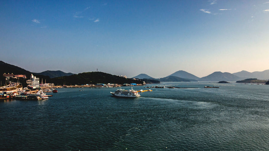 this photo was taken at Yeosu beach, Soth Korea. this is very famous island. EyeemSouthKorea Architecture Beauty In Nature Boat City Day Eyeemyeosu Mode Of Transport Moored Mountain Mountain Range Nature Nautical Vessel No People Outdoors Scenics Sea Sky Tranquil Scene Tranquility Transportation Travel Destinations Water Waterfront Yacht