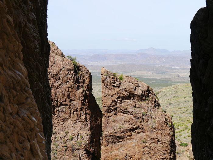 Huge rock formations at big bend national park against sky
