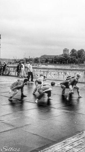 People Watching Taking Photos Dancers Riverside