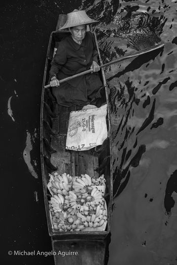 Floating Market Vendor Balck And White Bannana Bannanas Black And White Black And White Photography Daily Life Dailylife Day Floating Market Floating Village Floatingmarket Food Food And Drink For Sale Hat High Angle View Market One Person Outdoors Paddling Paddling Boat Real People Retail  Vendor On Boat Water The Photojournalist - 2018 EyeEm Awards