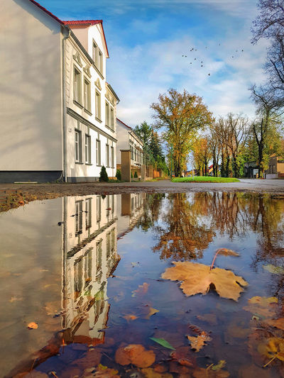 Architecture Autumn Beauty In Nature Building Exterior Built Structure Change Cloud - Sky Day Lake Leaf Nature No People Outdoors Puddle Reflecting Pool Reflection Sky Standing Water Tree Water Waterfront