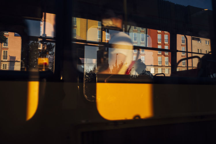 Reflection of orange on glass window