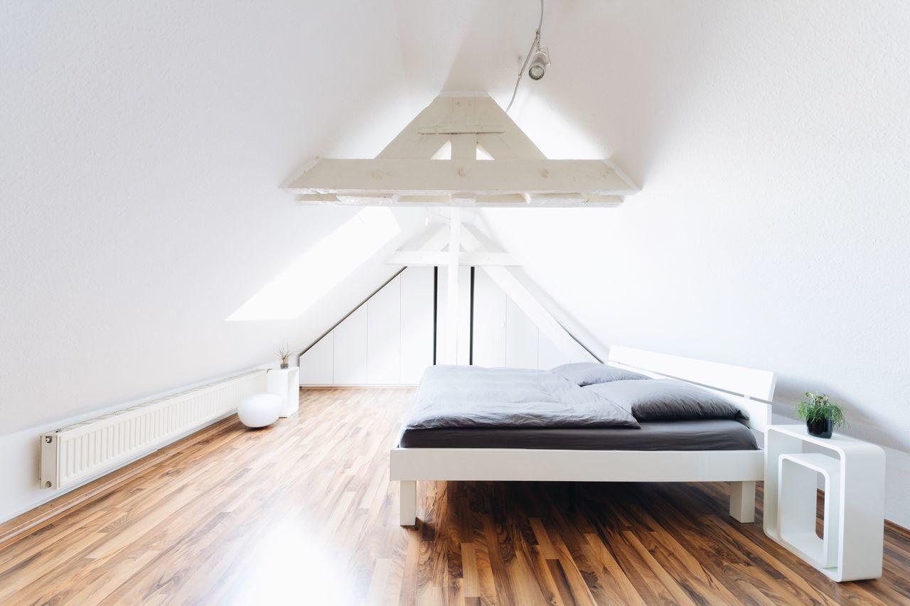 Interior of illuminated bedroom at home
