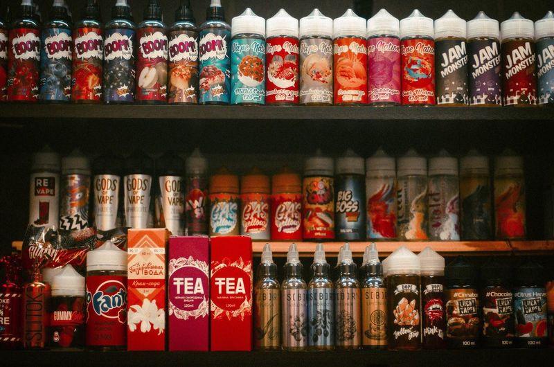 Multi colored bottles on shelf at shop