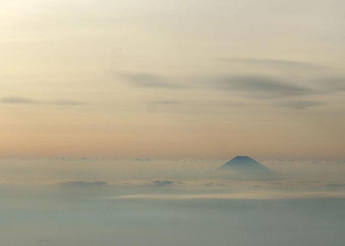 Idyllic Shot Of Mt Fuji In Foggy Weather Against Sky