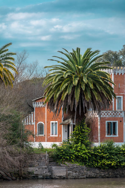 Gualeguaychu Architecture Argentina Building Building Exterior Built Structure Cloud - Sky Day Green Color Growth House Nature No People Outdoors Palm Tree Plant Residential District Sky Tree Tropical Climate Water Window The Great Outdoors - 2018 EyeEm Awards