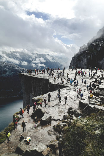 the preikestolen EyeEm EyeEm Best Shots EyeEm Nature Lover Hiking Norway Preikestolen Adventure Beauty In Nature Cloud - Sky Clouds Day Large Group Of People Mountain Nature Outdoors People Rocks Sky The Pulpit Rock Travel Destinations Vacations Water Fresh On Market 2017 A New Beginning A New Beginning
