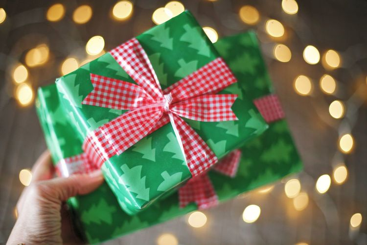 Midsection of person holding christmas decoration in box