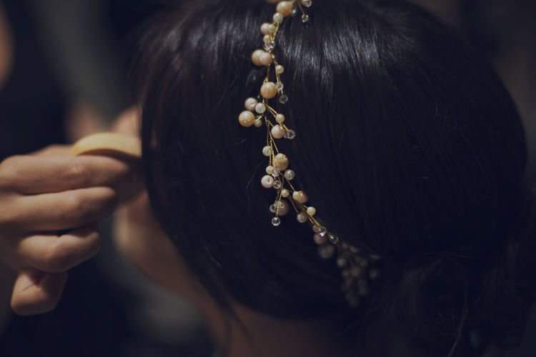 Midsection of woman. bride hair. makeup preparation