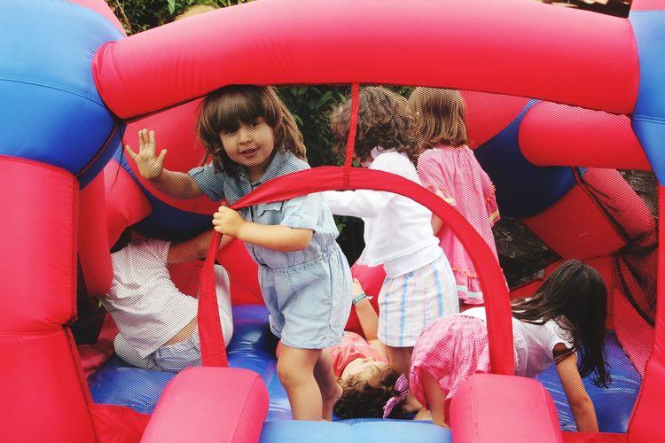 Girls enjoying in bouncy castle