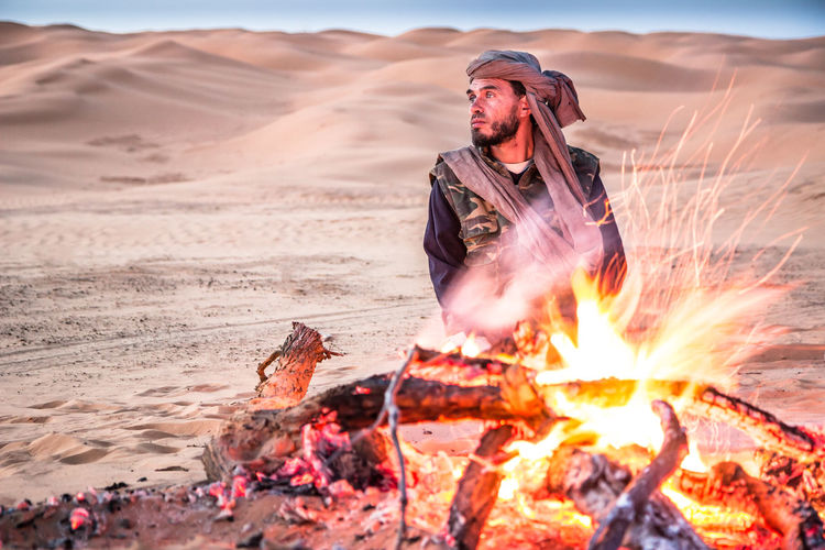 A berber in Sahara desert Land One Person Heat - Temperature Burning Fire - Natural Phenomenon Flame Fire Real People Nature Men Front View Leisure Activity Sky Bonfire Lifestyles Clothing Sand Desert Outdoors Campfire Desert Sahara Desert Landscape Berber  Tunisia My Best Photo