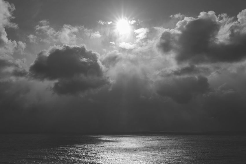 Monochrome Beauty In Nature Scenics Nature Tranquility Tranquil Scene Sunbeam Sky Sea Sunlight Water No People Day Cloud - Sky