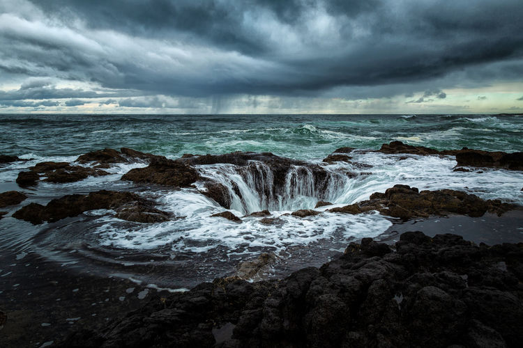 Thor's Well on the central Oregon coast, USA. Cloud - Sky Sky Sea Water Scenics - Nature Beauty In Nature Motion Overcast No People Nature Land Storm Beach Rock Horizon Over Water Rock - Object Environment Wave Outdoors Power In Nature Thor's Well Oregon Oregon Coast Oregon Beauty Danger