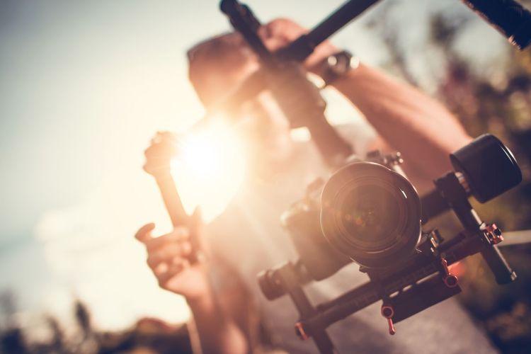 Man holding digital video camera on gimbal