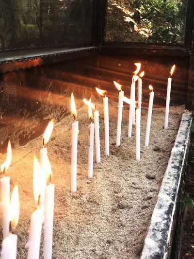 Flame Burning Fire Candle Heat - Temperature Nature Illuminated No People Fire - Natural Phenomenon Religion High Angle View Celebration Building Built Structure Melting Spirituality Belief Glowing EyeEmNewHere Autumn Mood