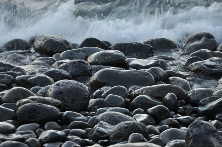 Beach Beauty In Nature Day Long Exposure Motion Nature No People Outdoors Pebble Pebble Beach Sea Volcanic Rocks Volcanic Stone Water