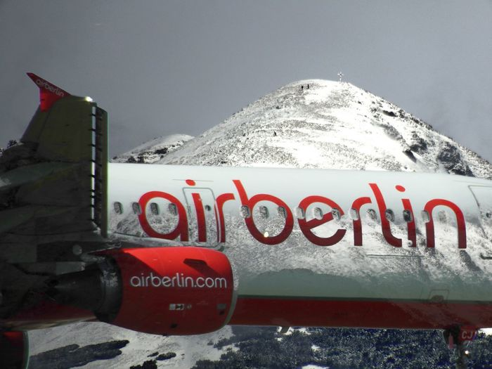 The goast of air berlin Plane Beauty In Nature Cold Temperature Day Frozen Mountain No People Outdoors Red Scenics - Nature Sky Snow Snowcapped Mountain Text Transportation Winter