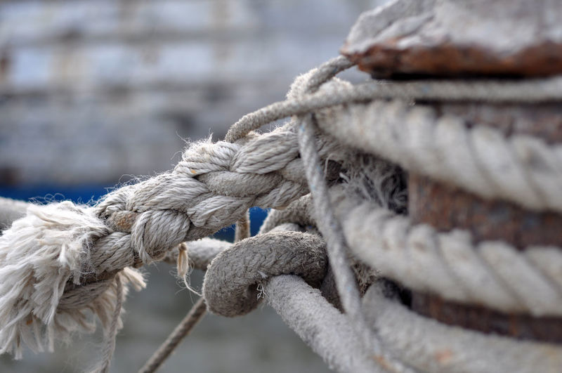 Close-up Complexity Connection Day Durability Focus On Foreground Metal Mode Of Transportation Nature Nautical Vessel No People Outdoors Rope Sailboat Selective Focus Strength Tied Knot Tied Up Transportation Twisted Water White Color
