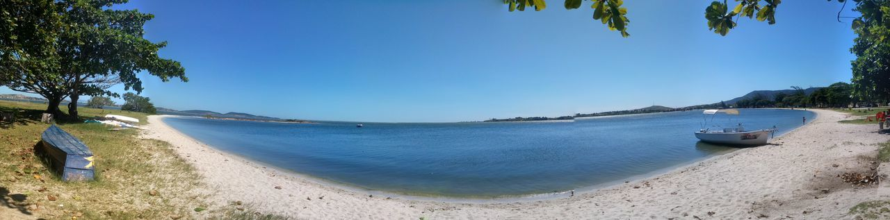 Panoramic shot of sea against clear blue sky