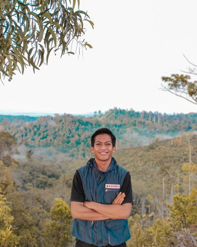 Portrait of a smiling young man standing on land