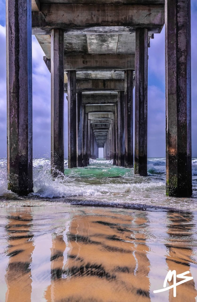 water, underneath, sea, architecture, below, connection, architectural column, pier, beach, day, nature, waterfront, bridge - man made structure, no people, built structure, outdoors, horizon over water, beauty in nature, sky, under